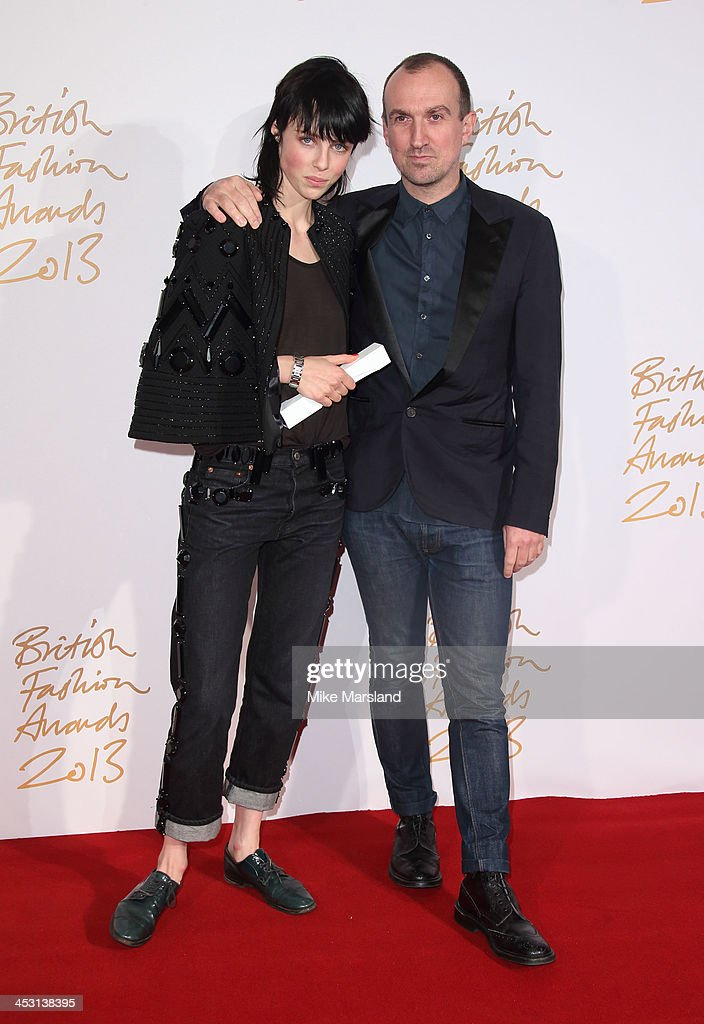 Edie Campbell and Tim Walker poses in the winners room at the British Fashion Awards 2013 at London Coliseum on December 2, 2013 in London, England.