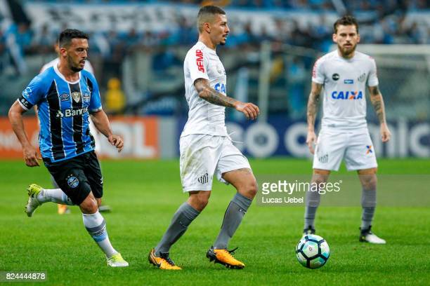 Edilson of Gremio battles for the ball against Alisson of Santos during the match Gremio v Santos as part of Brasileirao Series A 2017 at Arena do...