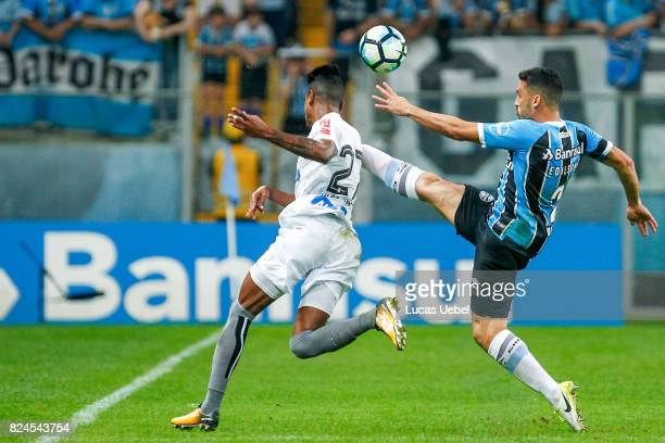 Edilson of Gremio battles for the ball against Bruno Henrique of Santos during the match Gremio v Santos as part of Brasileirao Series A 2017 at...