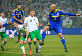 HERZEGOVINA NOVEMBER 13 Edin Cocalic of Bosnia in action against James McCarthy and Glenn Whelan of Ireland during the EURO 2016 Qualifier PlayOff...