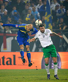 HERZEGOVINA NOVEMBER 13 Edin Cocalic of Bosnia jump for the ball against Daryl Murphy of Ireland during the EURO 2016 Qualifier PlayOff First Leg...