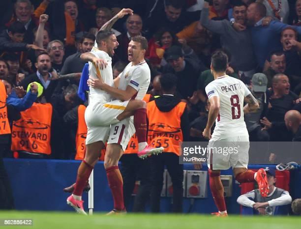 Edin Deko of Roma celebrates with Aleksandar Kolarov of Roma during UEFA Champions League Group C MATCH 3 match between Chelsea against AS Roma at...