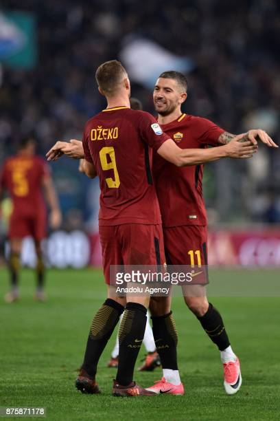 Edin Dzeko and Aleksandar Kolarov of AS Roma celebrate after winning the Italian Serie A soccer match between AS Roma and SS Lazio at the Stadio...