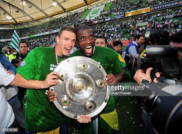 Edin Dzeko and Grafite of Wolfsburg celebrate the German championship with the trophy after their Bundesliga match against SV Werder Bremen on May 23...
