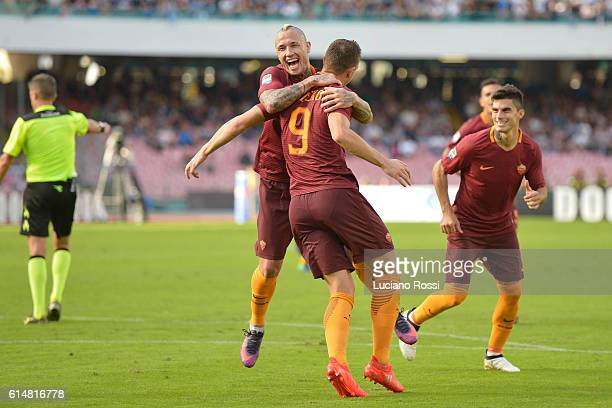 Edin Dzeko Diego Perotti and Radja Nainggolan of AS Roma celebate after a goal scored by Edin Dzeko during the Serie A match between SSC Napoli and...