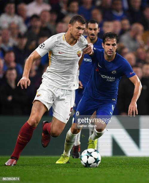 Edin Dzeko of AS Roma and Cesc Fabregas of Chelsea battle for possession during the UEFA Champions League group C match between Chelsea FC and AS...