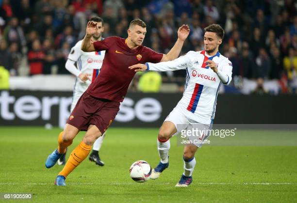Edin Dzeko of AS Roma and Emanuel Mammana of Lyon in action during the UEFA Europa League Round of 16 first leg match between Olympique Lyonnais and...