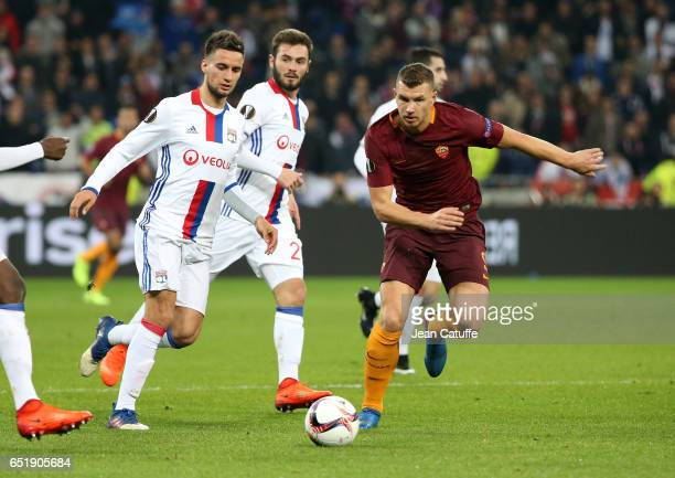 Edin Dzeko of AS Roma and Emanuel Mammana of Lyonj in action during the UEFA Europa League Round of 16 first leg match between Olympique Lyonnais and...