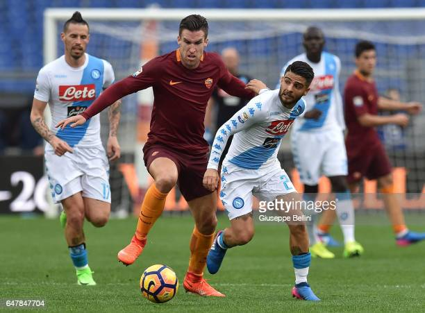 Edin Dzeko of AS Roma and Lorenzo Insigne of SSC Napoli in action during the Serie A match between AS Roma and SSC Napoli at Stadio Olimpico on March...