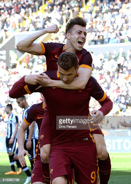 Edin Dzeko of AS Roma celebrate with his team's mate Stephan El Shaarawy after scoring his opening goal during the Serie A match between Udinese...