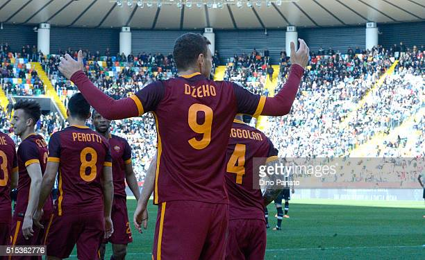 Edin Dzeko of AS Roma celebrates after scoring his opening goal during the Serie A match between Udinese Calcio and AS Roma at Stadio Friuli on March...