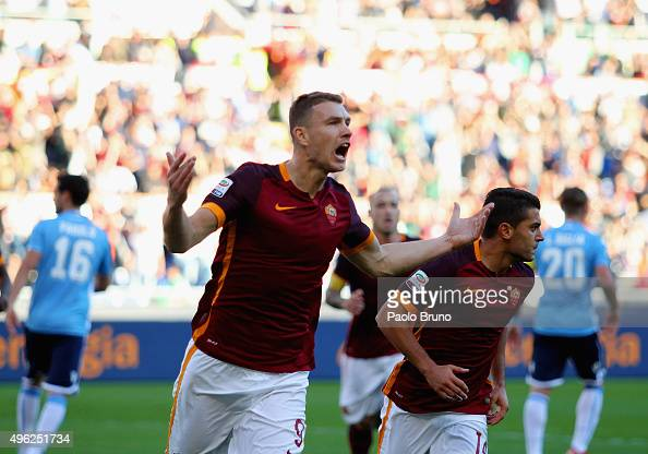 Edin Dzeko of AS Roma celebrates after scoring the opening goal from penalty spot during the Serie A match between AS Roma and SS Lazio at Stadio...