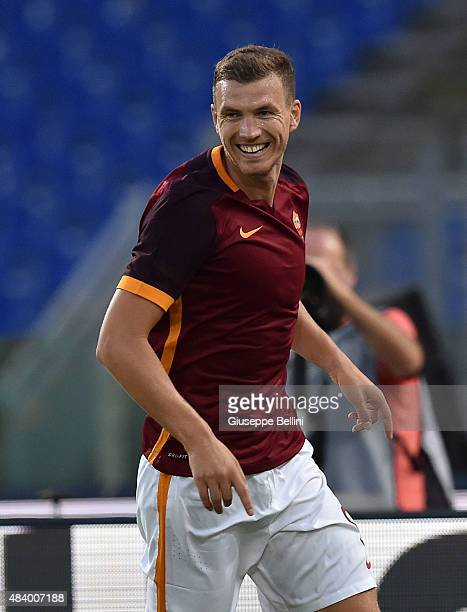 Edin Dzeko of AS Roma celebrates after scoring the opening goal during the preseason friendly match between AS Roma and Sevilla FC at Olimpico...