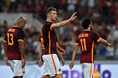 Edin Dzeko of AS Roma celebrates after scoring their third goal during the preseason friendly match between AS Roma and Sevilla FC at Olimpico...