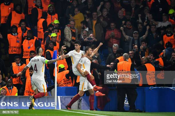 Edin Dzeko of AS Roma celebrates scoring his sides second goal with his AS Roma team mates during the UEFA Champions League group C match between...