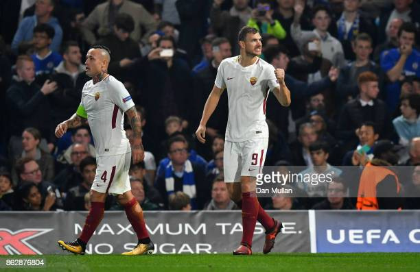 Edin Dzeko of AS Roma celebrates scoring his sides third goal during the UEFA Champions League group C match between Chelsea FC and AS Roma at...