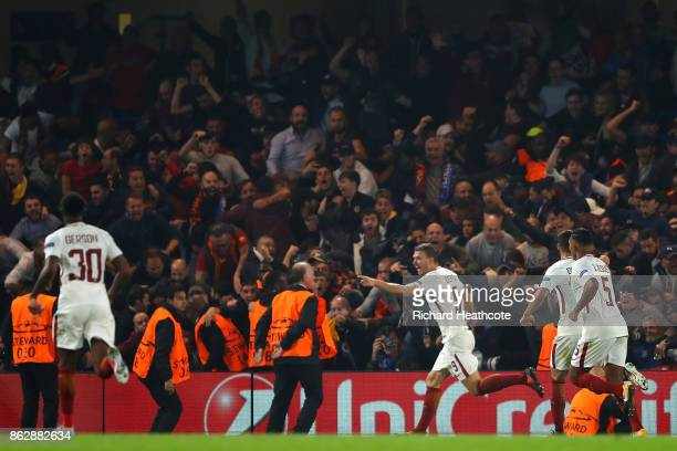 Edin Dzeko of AS Roma celebrates scoring his sides third goal with his AS Roma team mates during the UEFA Champions League group C match between...