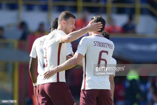 Edin Dzeko of AS Roma celebrates with Kevin Strootman after scoring a goal during the Serie A match between Bologna FC and AS Roma at Stadio Renato...