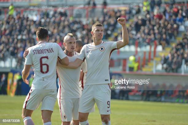 Edin Dzeko of AS Roma celebrates with teammates after scorin a goal during the Serie A match between FC Crotone and AS Roma at Stadio Comunale Ezio...