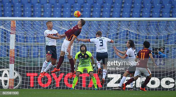 Edin Dzeko of AS Roma competes for the ball with Genoa CFC players during the Serie A match between AS Roma and Genoa CFC at Stadio Olimpico on...