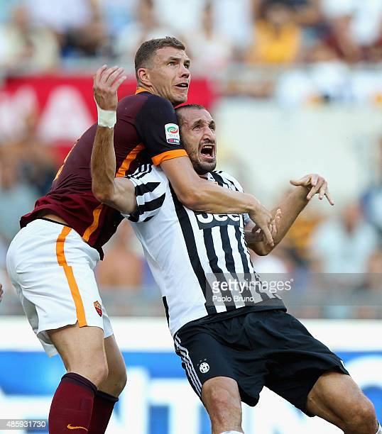 Edin Dzeko of AS Roma competes for the ball with Giorgio Chiellini of Juventus FC during the Serie A match between AS Roma and Juventus FC at Stadio...