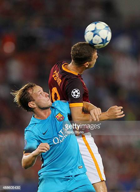 Edin Dzeko of AS Roma competes for the ball with Ivan Rakitic of FC Barcelona during the UEFA Champions League Group E match between AS Roma and FC...