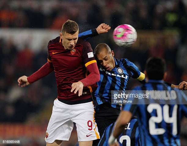 Edin Dzeko of AS Roma competes for the ball with Miranda of FC Internazionale Milano during the Serie A match between AS Roma and FC Internazionale...