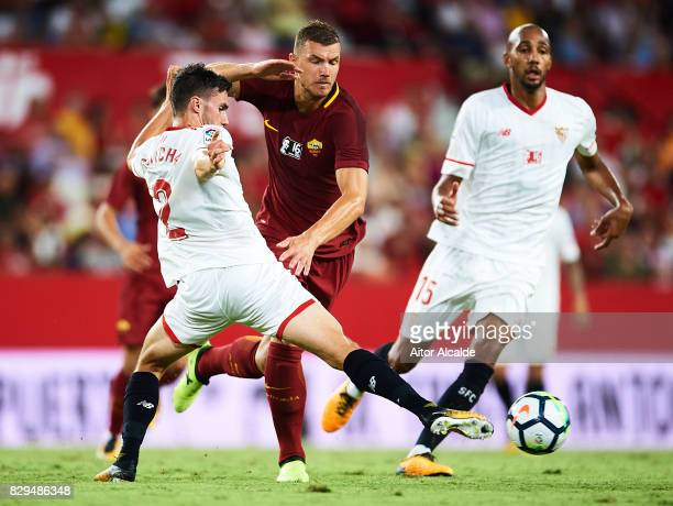 Edin Dzeko of AS Roma competes for the ball with Sebastien Corchia of Sevilla FC during a Pre Season Friendly match between Sevilla FC and AS Roma at...