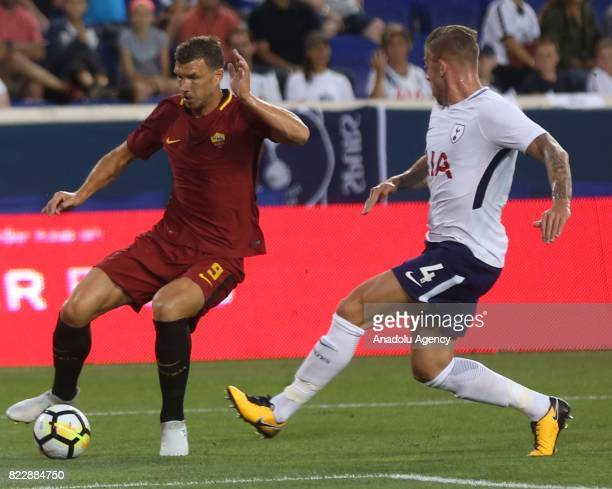 Edin Dzeko of AS Roma in action against Alderweireld of Tottenham Hotspur during a friendly match between AS Roma and Tottenham Hotspur within...