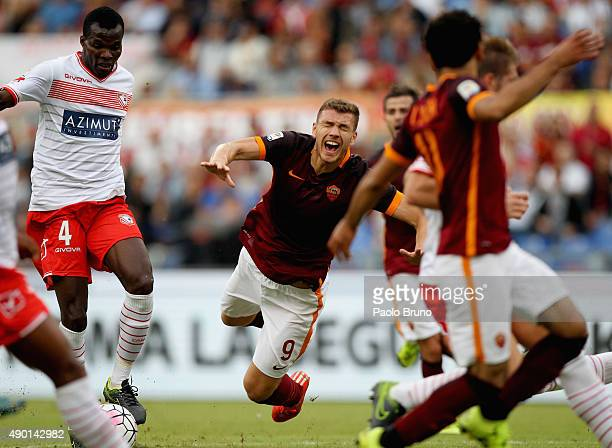 Edin Dzeko of AS Roma is fauled by Isaac Cofie of Carpi FC during the Serie A match between AS Roma and Carpi FC at Stadio Olimpico on September 26...