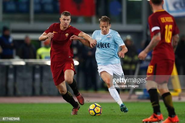 Edin Dzeko of AS Roma Lucas Leiva of Lazio during the Italian Serie A match between AS Roma v Lazio at the Stadio Olimpico on November 18 2017 in...
