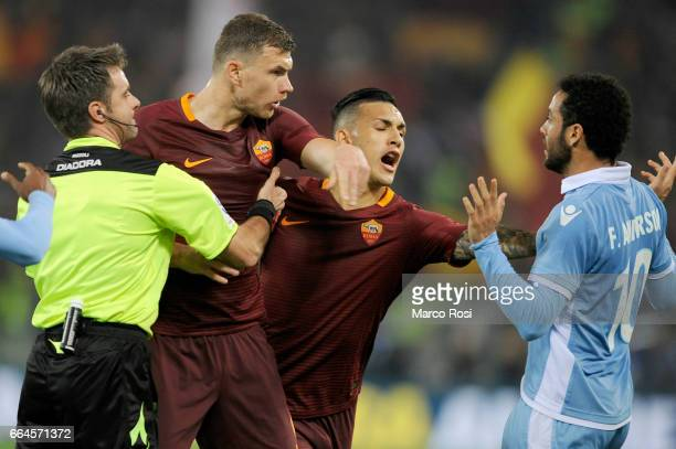 Edin Dzeko of As Roma reacts with Felipe Anderson of SS Lazio during the TIM Cup match between AS Roma and SS Lazio at Stadio Olimpico on April 4...