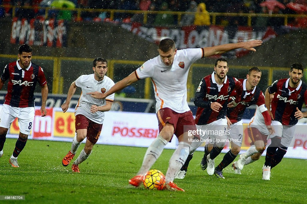 Edin Dzeko of AS Roma scores his team's second goal from the penalty spot during the Serie A match between Bologna FC and AS Roma at Stadio Renato...