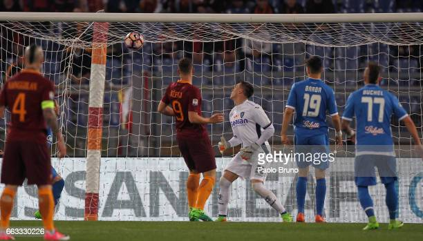 Edin Dzeko of AS Roma scores the opening goal during the Serie A match between AS Roma and Empoli FC at Stadio Olimpico on April 1 2017 in Rome Italy