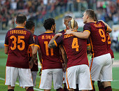Edin Dzeko of AS Roma with team mates celebrate him scoring the opening goal from penalty spot during the Serie A match between AS Roma and SS Lazio...