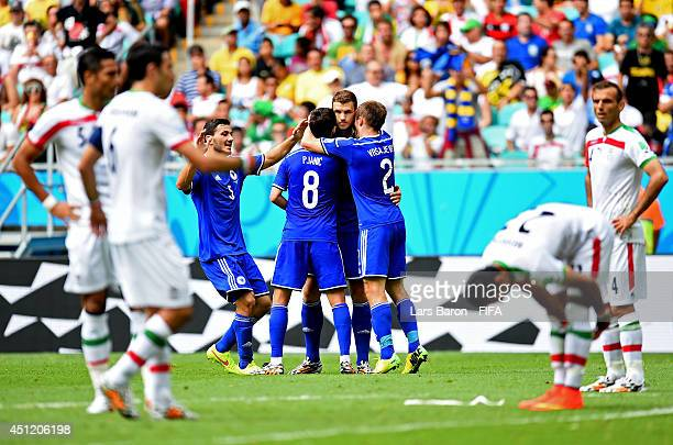 Edin Dzeko of Bosnia and Herzegovina celebrates scoring his team's first goal with his teammates during the 2014 FIFA World Cup Brazil Group F match...