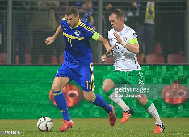 HERZEGOVINA NOVEMBER 13 Edin Dzeko of Bosnia in action against Glenn Whelan of Ireland during the EURO 2016 Qualifier PlayOff First Leg match at...