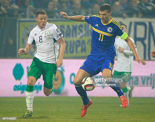 HERZEGOVINA NOVEMBER 13 Edin Dzeko of Bosnia in action against James McCarthy of Ireland during the EURO 2016 Qualifier PlayOff First Leg match at...