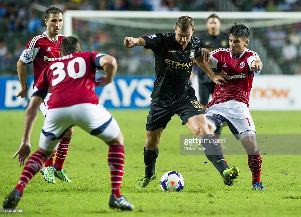 <a gi-track='captionPersonalityLinkClicked' href=/galleries/search?phrase=Edin+Dzeko&family=editorial&specificpeople=4404455 ng-click='$event.stopPropagation()'>Edin Dzeko</a> (C) of Manchester City and Aender Naves of South China during the Barclays Asia Trophy Semi Final match between Manchester City and South China at Hong Kong Stadium on July 24, 2013 in So Kon Po, Hong Kong.