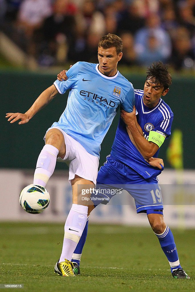 <a gi-track='captionPersonalityLinkClicked' href=/galleries/search?phrase=Edin+Dzeko&family=editorial&specificpeople=4404455 ng-click='$event.stopPropagation()'>Edin Dzeko</a> #10 of Manchester City and <a gi-track='captionPersonalityLinkClicked' href=/galleries/search?phrase=Paulo+Ferreira+-+Soccer+Player&family=editorial&specificpeople=185237 ng-click='$event.stopPropagation()'>Paulo Ferreira</a> #19 of Chelsea fight for control of a loose ball during a friendly match at Busch Stadium on May 23, 2013 in St. Louis, Missouri.