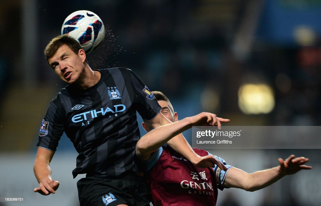 <a gi-track='captionPersonalityLinkClicked' href=/galleries/search?phrase=Edin+Dzeko&family=editorial&specificpeople=4404455 ng-click='$event.stopPropagation()'>Edin Dzeko</a> of Manchester City battles with <a gi-track='captionPersonalityLinkClicked' href=/galleries/search?phrase=Ciaran+Clark&family=editorial&specificpeople=4644641 ng-click='$event.stopPropagation()'>Ciaran Clark</a> of Aston Villa during the Barclays Premier League match between Aston Villa and Manchester City at Villa Park on March 4, 2013 in Birmingham, England.