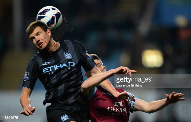 Edin Dzeko of Manchester City battles with Ciaran Clark of Aston Villa during the Barclays Premier League match between Aston Villa and Manchester...