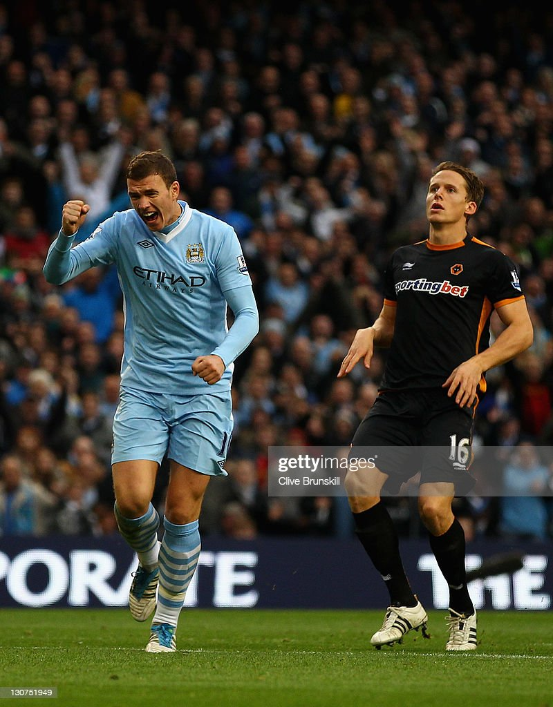 <a gi-track='captionPersonalityLinkClicked' href=/galleries/search?phrase=Edin+Dzeko&family=editorial&specificpeople=4404455 ng-click='$event.stopPropagation()'>Edin Dzeko</a> of Manchester City celebrates after scoring the first goal during the Barclays Premier League match between Manchester City and Wolverhampton Wanderers at Etihad Stadium on October 29, 2011 in Manchester, England.