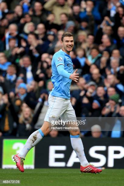 Edin Dzeko of Manchester City celebrates after scoring the opening goal during the Barclays Premier League match between Manchester City and Cardiff...