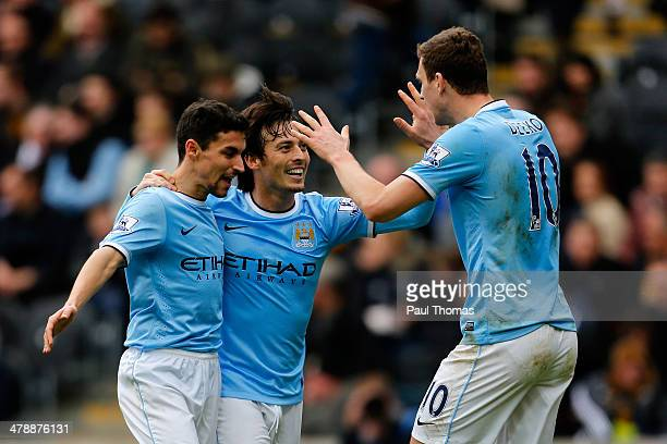Edin Dzeko of Manchester City celebrates his goal with team mates Jesus Navas and David Silva during the Barclays Premier League match between Hull...