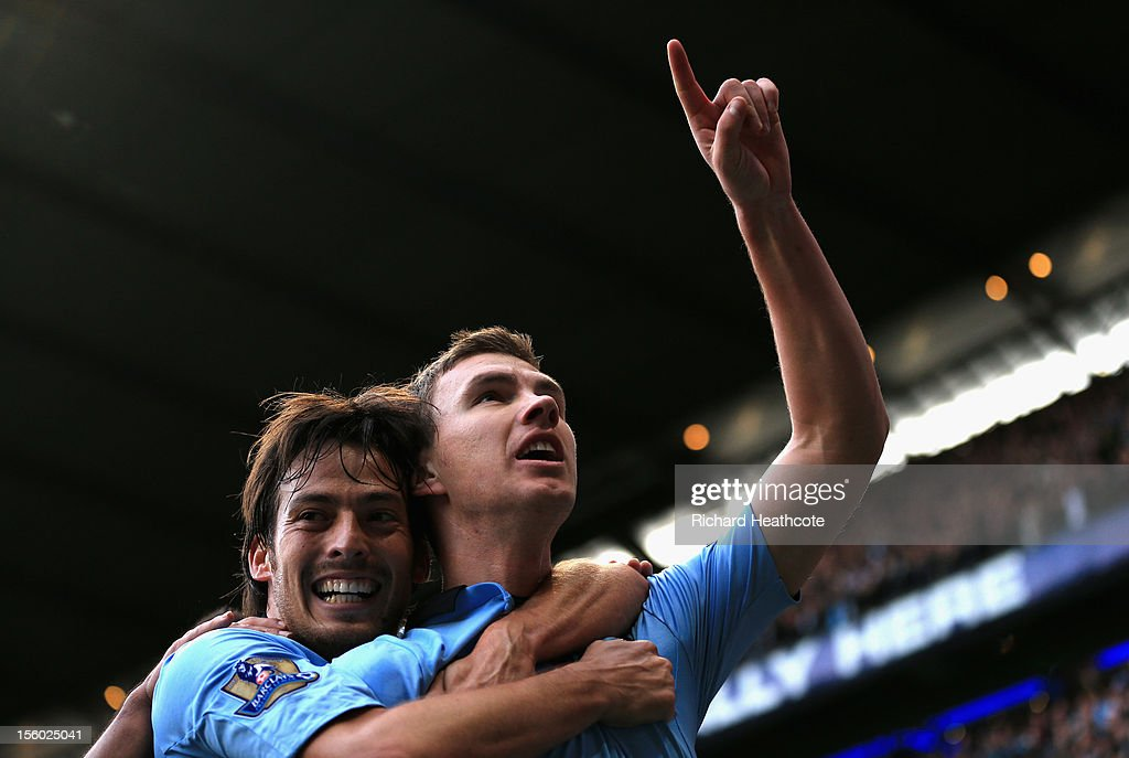<a gi-track='captionPersonalityLinkClicked' href=/galleries/search?phrase=Edin+Dzeko&family=editorial&specificpeople=4404455 ng-click='$event.stopPropagation()'>Edin Dzeko</a> of Manchester City celebrates scoring his team's second goal with team-mate <a gi-track='captionPersonalityLinkClicked' href=/galleries/search?phrase=David+Silva&family=editorial&specificpeople=675795 ng-click='$event.stopPropagation()'>David Silva</a> (L) during the Barclays Premier League match between Manchester City and Tottenham Hotspur at the Etihad Stadium on November 11, 2012 in Manchester, England.