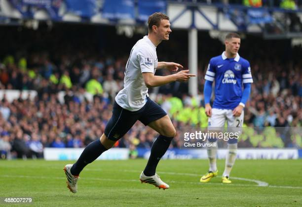 Edin Dzeko of Manchester City celebrates scoring his team's third goal during the Barclays Premier League match between Everton and Manchester City...