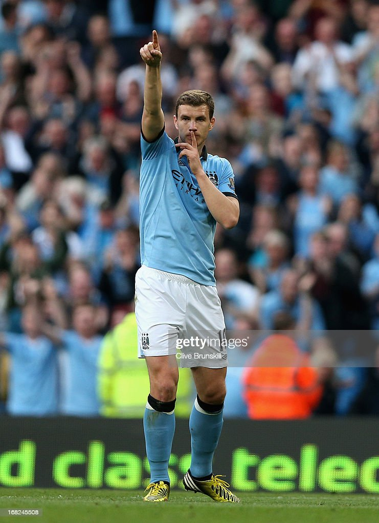 Edin Dzeko of Manchester City celebrates scoring the opening goal during the Barclays Premier League match between Manchester City and West Bromwich Albion at the Etihad Stadium on May 07, 2013 in Manchester, England.