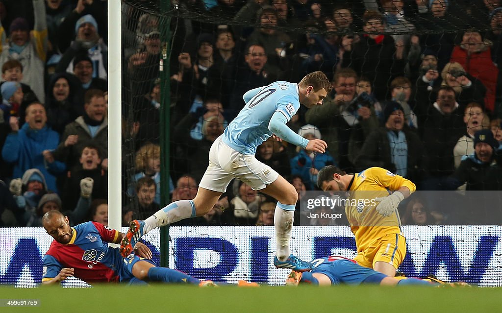 <a gi-track='captionPersonalityLinkClicked' href=/galleries/search?phrase=Edin+Dzeko&family=editorial&specificpeople=4404455 ng-click='$event.stopPropagation()'>Edin Dzeko</a> of Manchester City celebrates scoring the opening goal during the Barclays Premier League match between Manchester City and Crystal Palace at the Etihad Stadium on December 28, 2013 in Manchester, England.