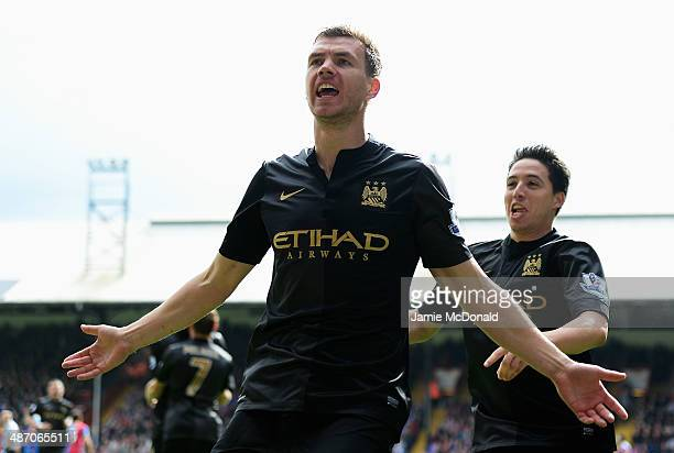 Edin Dzeko of Manchester City celebrates scoring the opening goal with Samir Nasri of Manchester City during the Barclays Premier League match...